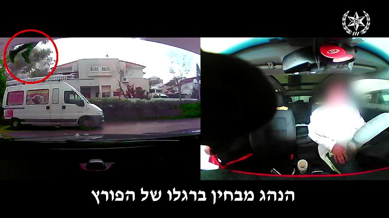הפורץ נקלט בעין המצלמה (צילום: דוברות המשטרה)